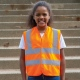 School wear hi vis vest for enhanced visibility safety worn over school uniform