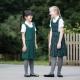 Junior school pinafores plain and tartan designs in school uniform colours